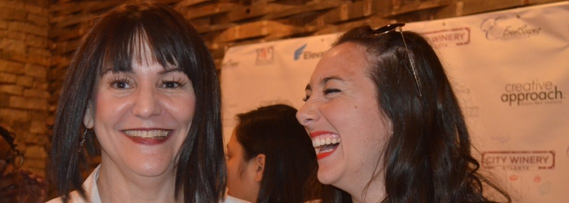 Two_Women_Laughing_at_Event_Handwriting_Analysis_Backdrop