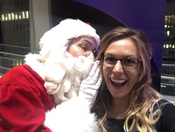 Santa Whispering to Young Woman