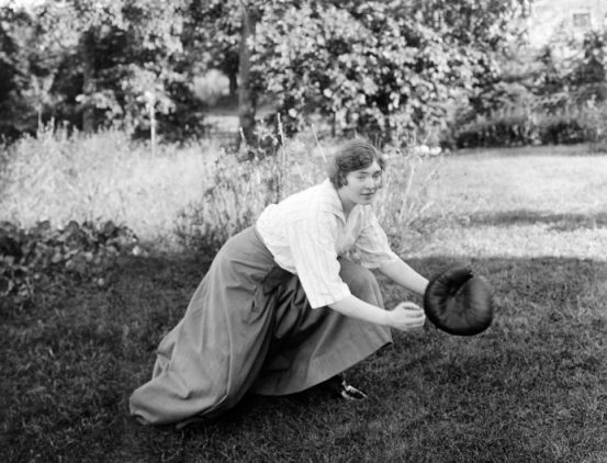 Woman playing baseball by the rules circa 1920's